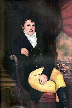 Manuel Belgrano durante su estadía en Londres; obra al óleo sobre tela de François Casimir Carbonnier, la imagen del fondo reproduce el primer izado de la Bandera Argentina.