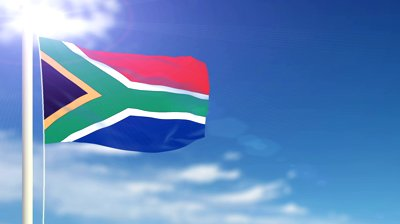 stock-footage-south-africa-flag-waving-sky-background-seamless-loop